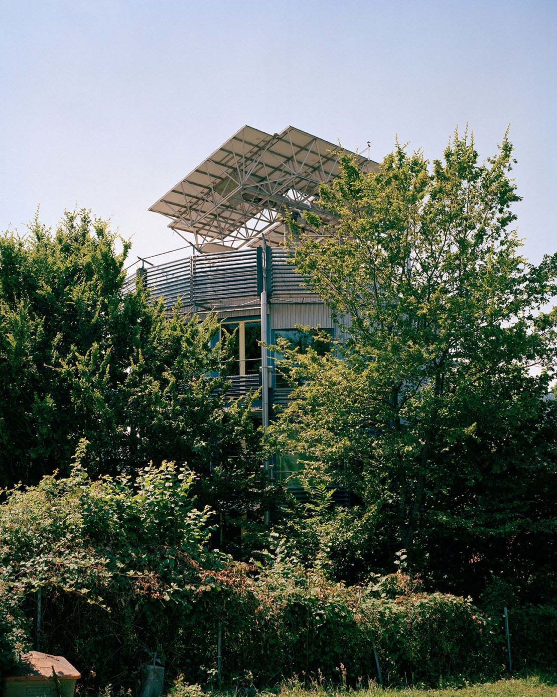 An experimental house, with roof solar panels and a spinning mechanism to follow sunlight, built by resident Rolf Disch in 1994