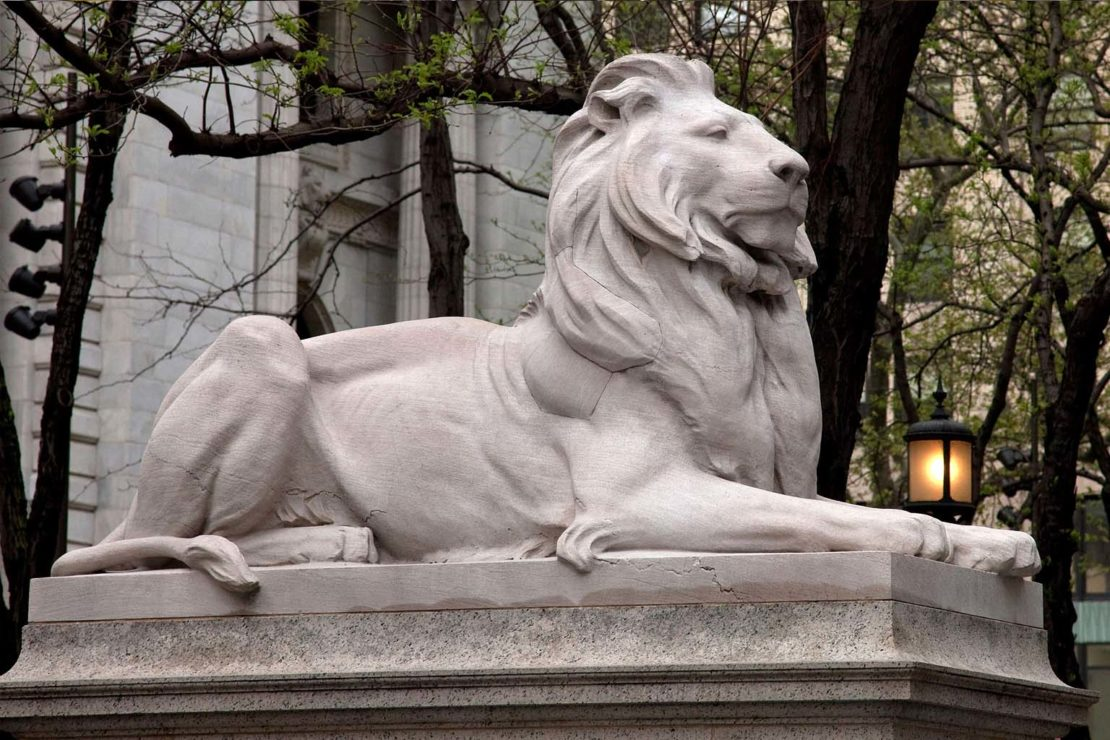 A lion statue guards the Fifth Avenue entrance to the library