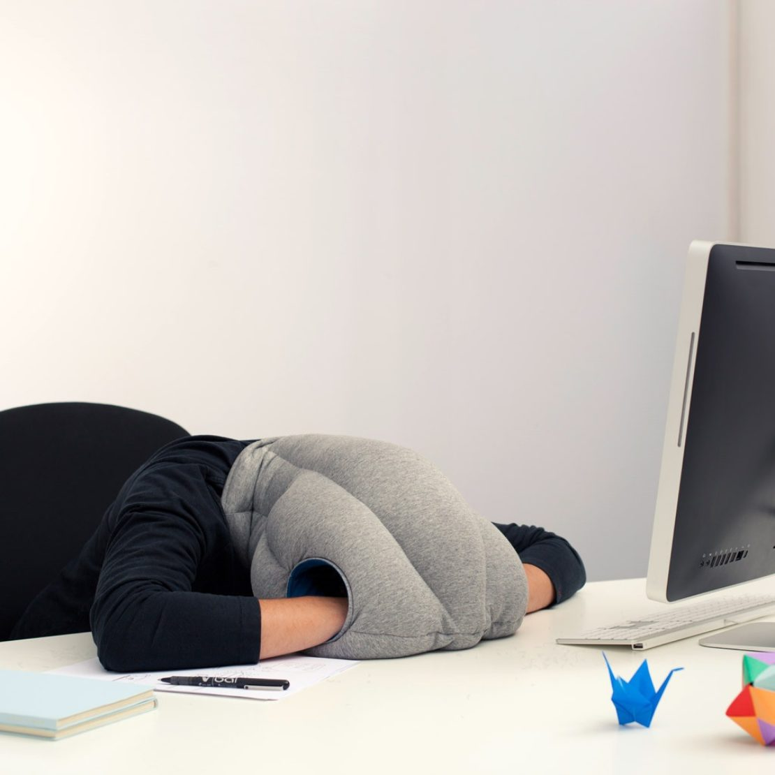 The Ostrich Pillow, for at-desk sleeping