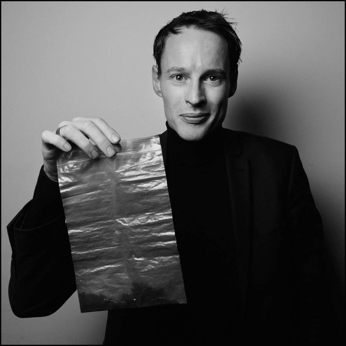 Daan Roosegaarde holds a bag of collected smog particles