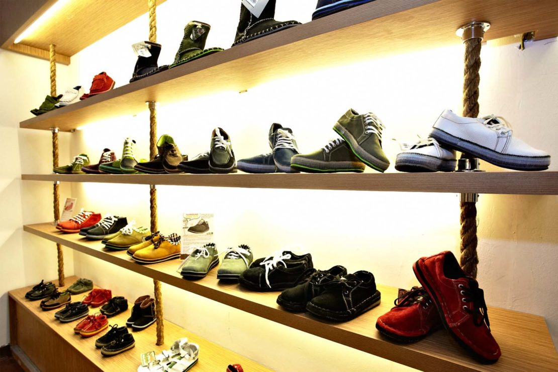 Dozens of soleRebels shoes on display at one of its shops
