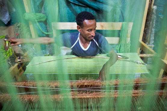 soleRebels' artisan factory workers use traditional methods, spinning cotton with an inzert spindle and weaving with traditional wooden loom