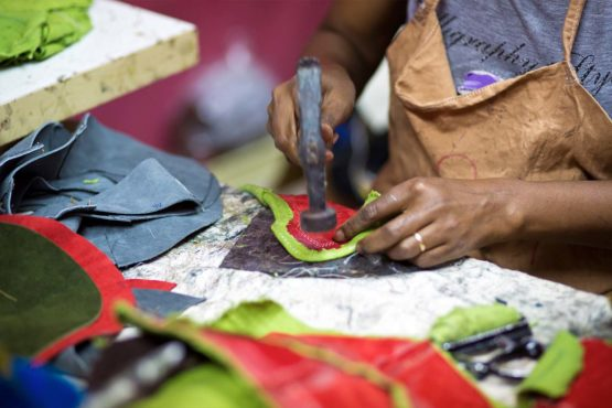 Artisans hammer out shoe fabric by hand